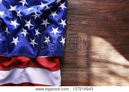 Flag of United States of America on wooden background