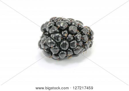 Juicy ripe dark blackberry fruit on white background