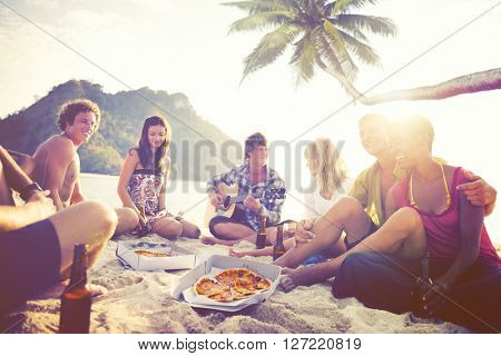Group of Cheerful Young People Relaxing on a Beach