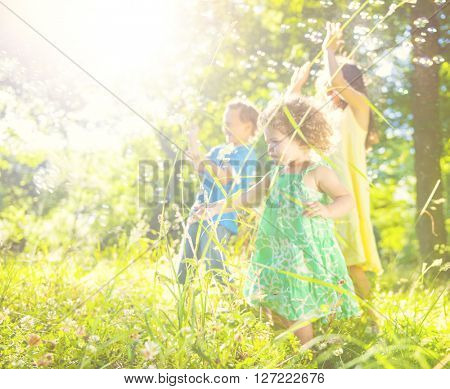 Little children playing together outdoors.