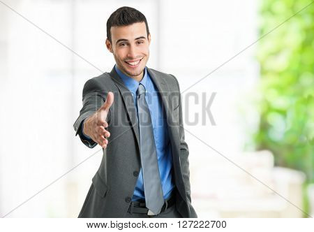 Portrait of a friendly businessman offering an handshake