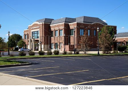 PLAINFIELD, ILLINOIS / UNITED STATES - SEPTEMBER 20, 2015: The First Midwest Bank offers banking services in downtown Plainfield.