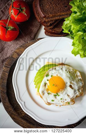 Breakfast toast with fried egg, overhead view