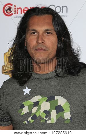LAS VEGAS - APR 12:  Adam Beach at the Warner Bros. Pictures Presentation at CinemaCon at the Caesars Palace on April 12, 2016 in Las Vegas, CA