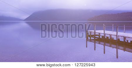 Tranquil peaceful lake with jetty , New Zealand.