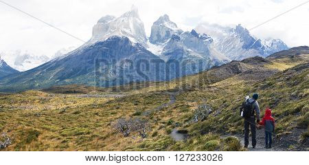 panorama of family enjoying active vacation and view of cuernos del paine famous peaks in torres del paine national park patagonia chile