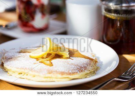 sweet ricotta pancakes with lemon jam served at the restaurant for breakfast