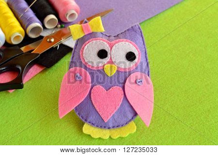 Cute felt owl. Scissors, thread, felt sheets, needle, sewing kit