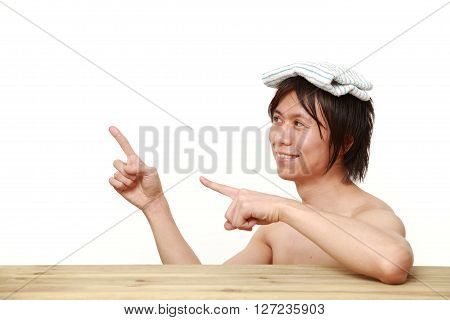 young Japanese man relaxing Japanese traditiona bath