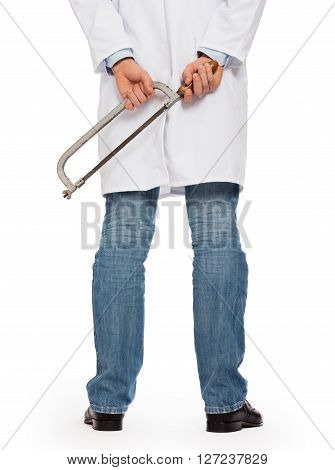 Crazy doctor is holding a big saw in his hands isolated on white