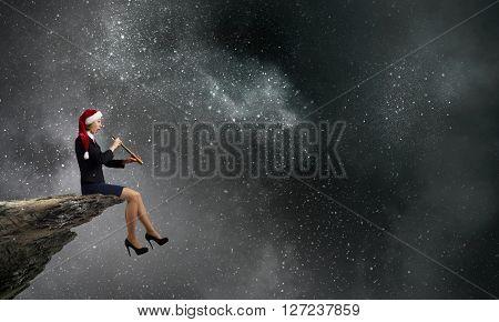 Santa woman using spyglass