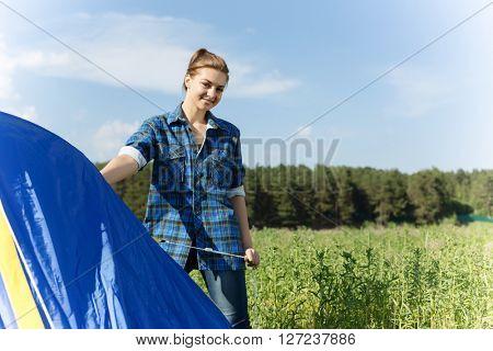 Woman fixing tent