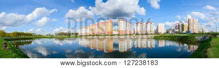 GOMEL BELARUS - APRIL 23 2016: Unidentified people are resting in a modern recreation area with a cascade of lakes in Volotova district Gomel Belarus