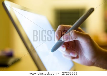 Woman using pen on tablet pc