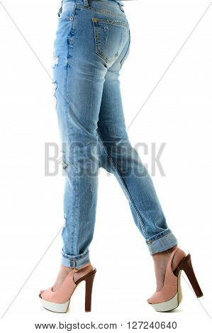 Woman in hot pink high heels and jeans. closeup of lower half body isolated on white background.