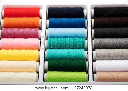 Colorful bobbins thread in plastic box