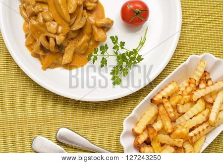 Zurich ragout with French fries and tomato