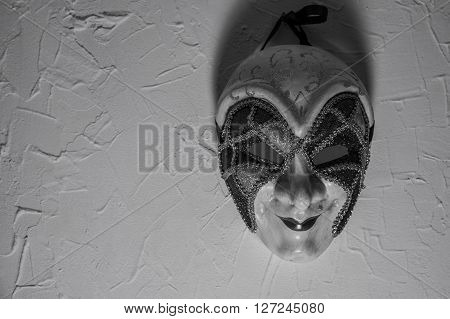 Sinister Joker mask on a white wall