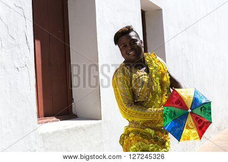 Young Brazilian man dancing Frevo in Olinda, Brazil