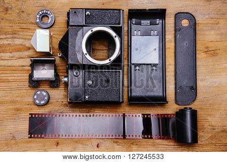 Disassembled rangefinder camera. isolated on wooden background.