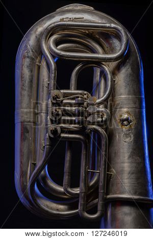fragment of silver tuba isolated on black background