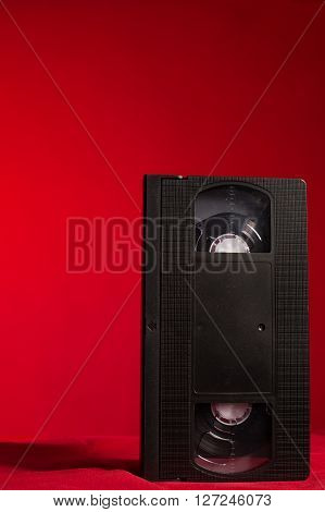 video tape on a red background in studio