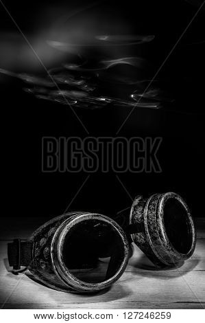 Steampunk glasses metal collage. light brush. dark backgriound