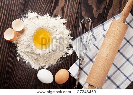 Kitchen table with utensils and ingredients. Top view