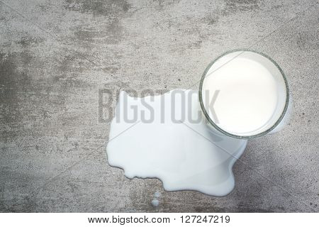Spilt Milk And A Glass Of Milk On Concrete Table