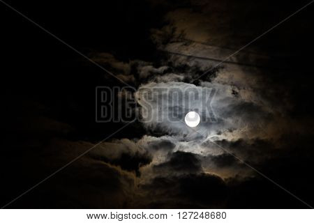 Night sky and a full moon in the clouds. Night sky and a full moon in the clouds