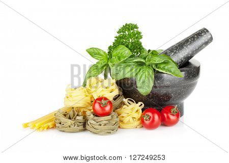 Italian food: pasta, tomatoes, fresh herbs in mortar. Isolated on white background