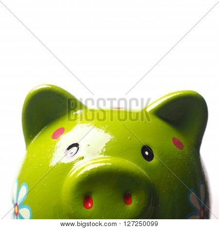Funny green piggy bank on a white background