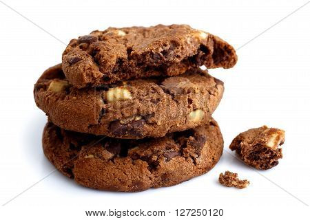 Stack Of Three Dark Chocolate Chip Cookies Isolated. One Broken With Crumbs.
