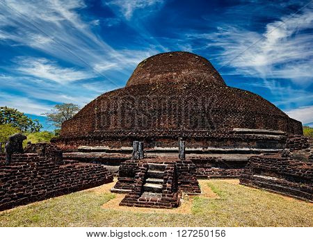 Sri Lanka tourist landmark - ancient Buddhist dagoba (stupe) Pabula Vihara. Ancient city of Pollonaruwa, Sri Lanka