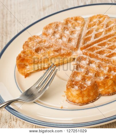 Sweet waffle on a rustic plate in a kitchen