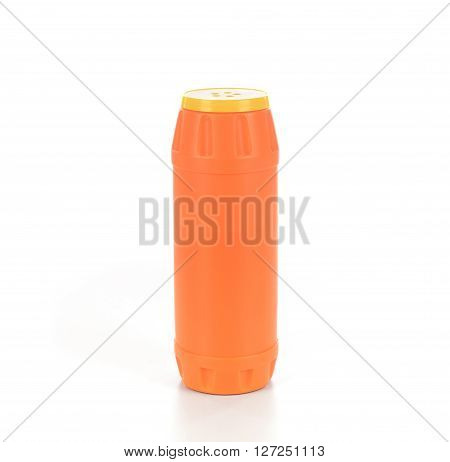 Orange plastic bottle with detergent powder isolated on white background.