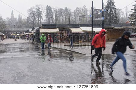 ZAKOPANE POLAND - APRIL 24 2016: Cable car from Zakopane to mount Gubalowka on 24 April 2016 in Zakopane Poland. Winter view of the lower station of the cableway to mount Gubalowka - a popular tourist attraction in Zakopane