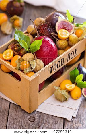 Exotic fruits in a crate with kumquats and figs