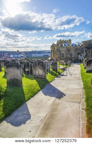 Whitby Churchyard and Cemetery in North Yorkshire in England. It is ruins of the Benedictine abbey. Now it is under protection of the English Heritage.