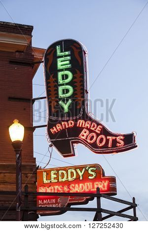FORT WORTH TX USA - APR 6: Leddy Hand Made Boots shop in the Fort Worth Stockyards district illuminated at dusk. April 6 2016 in Fort Worth Texas USA
