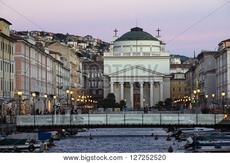 TRIESTE ITALY - OCTOBER 21: scenic evening city scene with view to New Sant'Antonio Church at the end of the Grand Canal in Trieste Italy on October 21 2015.