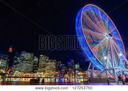 Sydney Australia - November 10 2015: Darling Harbour Ferris wheel at night time. Long exposure camera settings applied.