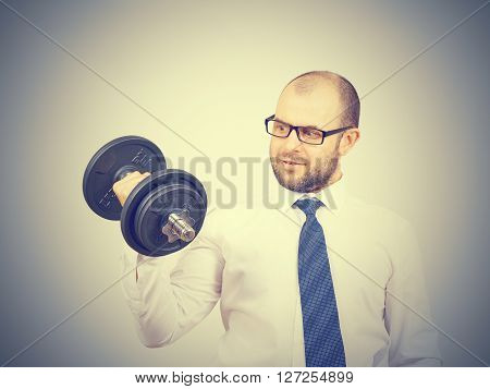 Man Trained Businessman Raises Dumbbell.