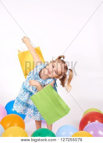 Shopping Child. Little Girl Holding Shopping Bags