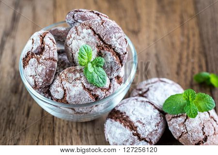 Bowl Of Chocolate Cookies On The Wooden Background