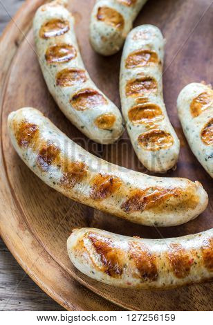 Grilled Sausages On The Wooden Board