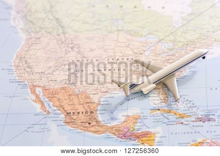 Passenger Airplane Miniature On A Map Taking Off From Usa