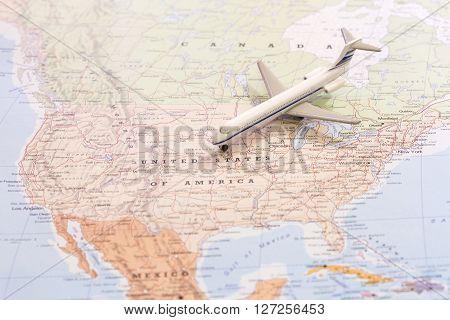 Travel Destination Usa. Passenger Airplane Miniature On A Map