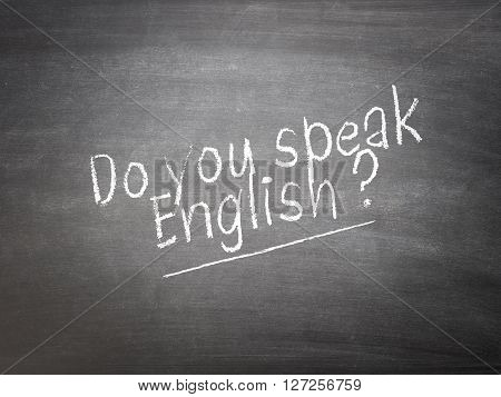 Learning language concept on a blackboard with the words Do you speak English?