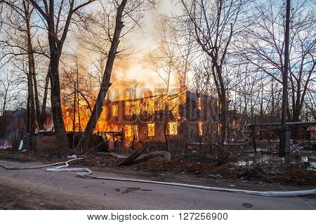 two-storey house  covered with fire (house on fire)